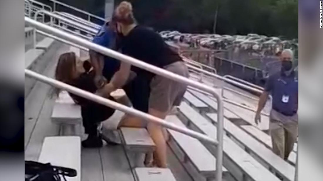 Woman tased after refusing to wear a mask at football game