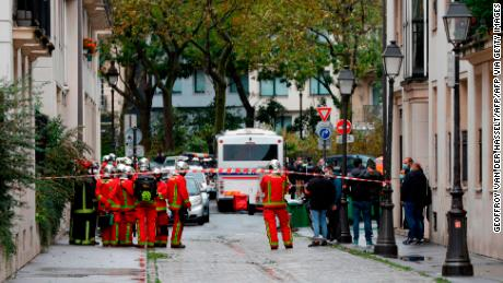 French firefighters are pictured near the scene of a knife attack in Paris on September 25.