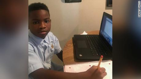 Ka'Mauri Harrison, 9, pictured in his Louisiana home participating in virtual learning.