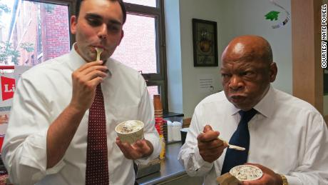 """March"" co-authors Andrew Aydin and Rep. John Lewis sample ice cream at Michigan State University in 2014. (Courtesy Nate Powell)"