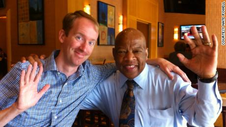 """March"" artist Nate Powell with Rep. John Lewis at an industry lunch in 2013. (Courtesy Nate Powell)"