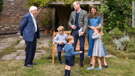 The royal family meets with naturalist David Attenborough.