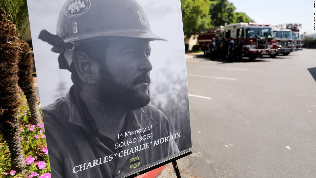 A photograph of Charles Morton, a firefighter killed battling the El Dorado wildfire, is displayed at a memorial service for Morton on Friday, September 25 in San Bernardino, California. Morton was a 14-year veteran of the US Forest Service and a squad boss with the Big Bear Hotshot Crew of the San Bernardino National Forest.