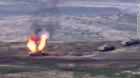 A photo released by the Armenian Defense Ministry appears to show an Azerbaijani tank being destroyed on Sunday, September 27, 2020.