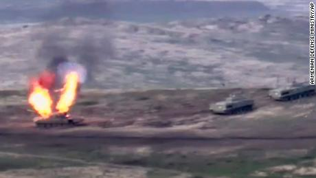 A photo released by the Armenian Defense Ministry appears to show an Azerbaijani tank being destroyed on Sunday.