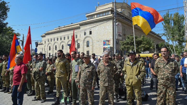 Servicemen and volunteers gather in Yerevan, Armenia, on Sunday after the Armenian government imposed martial law and ordered a general military mobilization due to clashes with Azerbaijan.