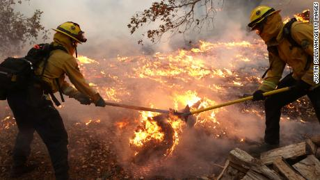 Marin County firefighters tackle the glass fire on Sunday, September 27, in Calistoga, California.