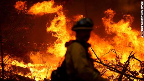 A Marin County firefighter battles the glass fire on Sunday, September 27 in Calistoga, California.
