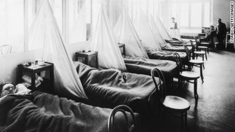 Patients lie in a US Army influenza ward in Aix-les-Baines, France, during World War I.