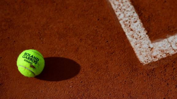 The 2020 French Open tennis tournament official ball is pictured on the tennis court during The Roland Garros 2020 French Open tennis tournament in Paris on September 26, 2020. (Photo by Martin BUREAU / AFP) (Photo by MARTIN BUREAU/AFP via Getty Images)