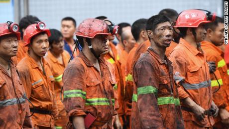 Rescuers wait outside the Songzao Coal Mine near Chongqing, in southwest China on September 27, 2020.