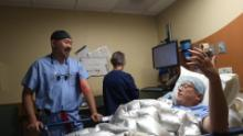 Dr. Demetrio Aguila consults with M25 patient Jeff Jensen prior to his surgery.