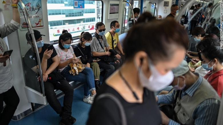 Passengers ride the subway in Wuhan, in China's central Hubei province on September 28, 2020. The city where cases of the coronavirus were first detected has largely returned to normal.