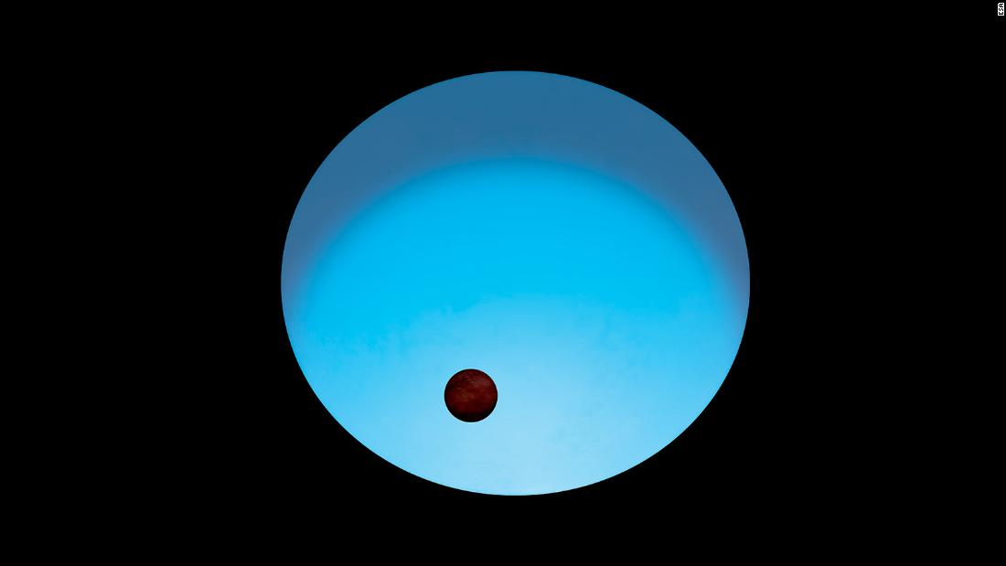 This is an artist's impression of exoplanet WASP-189 b orbiting its host star. The star appears to glow blue because it's more than 2,000 degrees hotter than our sun. The planet, which is slightly larger than Jupiter, has a tilted orbit around the star's poles rather than its equator.