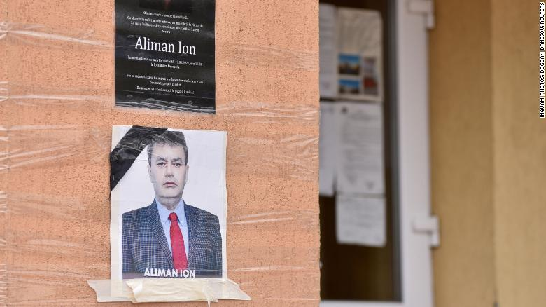 An obituary photo of former mayor Ion Aliman taped to the walls of the city hall in Deveselu, southern Romania, on Monday.