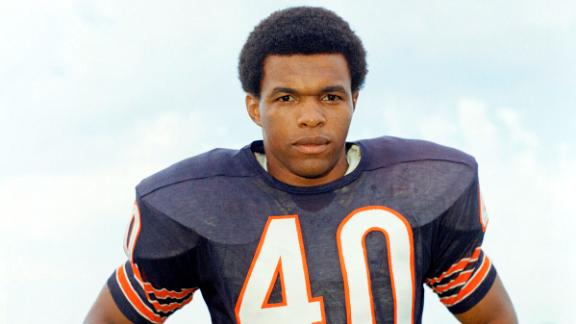 """NFL legend <a href=""""https://www.cnn.com/2020/09/23/us/gale-sayers-chicago-bears-dead-spt-trnd/index.html"""" target=""""_blank"""">Gale Sayers</a>, widely regarded as one of the greatest running backs to ever carry a football, died September 23 at the age of 77. At 34, Sayers became the youngest player ever inducted into the Hall of Fame. His short seven-season career was cut short by injuries to both knees, but not before twice leading the league in rushing and earning five first-team All-Pro selections."""