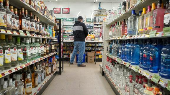 WESTBROOK, ME - APRIL 22: A customer gets rung out at Friendly Discount liquor store in Westbrook on Wednesday, April 22, 2020. According to the state, liquor sales in Maine increased by 16 percent in March and April. (Staff Photo by Gregory Rec/Portland Press Herald via Getty Images)