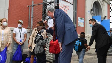 New York Mayor Bill de Blasio visits Public School 188 in Manhattan on Tuesday as elementary school reopens.