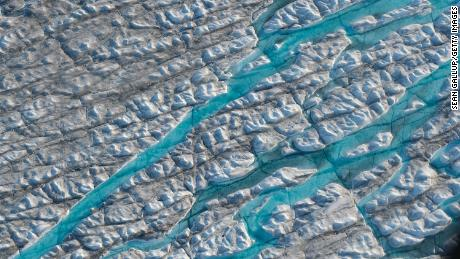 Meltwater carves into the ice sheet near the Sermeq Avangnardleq glacier in Greenland in August 2019.