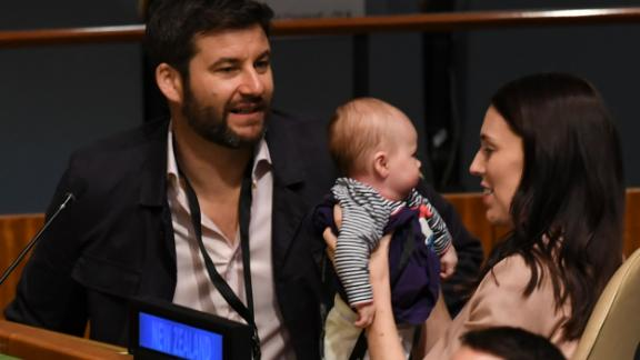 Jacinda Ardern holds her daughter Neve Te Aroha Ardern Gayford, as her partner Clarke Gayford looks on during the Nelson Mandela Peace Summit on September 24, 2018, a day before the General Debate of the General Assembly at the United Nations in New York.