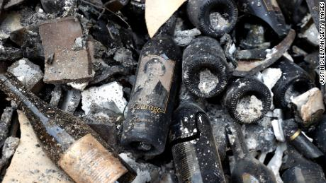 Damaged bottles of wine lay on the floor at Fairwinds Estate Winery that was destroyed by the Glass Fire.