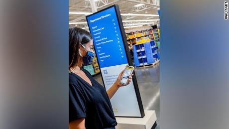 The new Walmart sign mimics an airport.