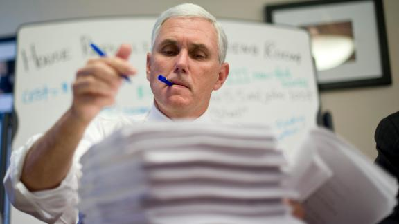 Pence makes marks on a House health-care bill in 2009.