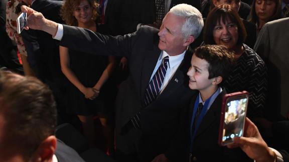Pence takes a selfie before a presidential debate in Hempstead, New York, in September 2016.