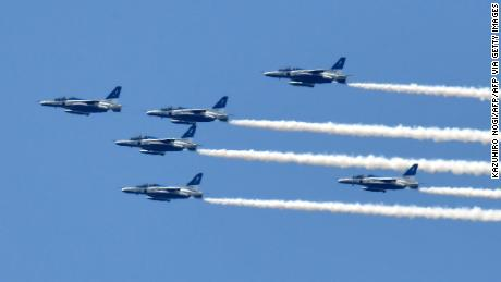 The Blue Impulse aerobatic demonstration team of Japan's Air Self-Defense Force flies over Tokyo to thank  medical workers for their efforts fighting the pandemic on May 29.