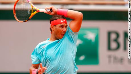 Nadal plays a forehand during his match against McDonald.