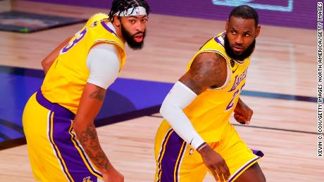 Anthony Davis (left) and LeBron James (right) made a combined 59 points, 22 rebounds and 14 assists in Game 1 of the NBA Finals.