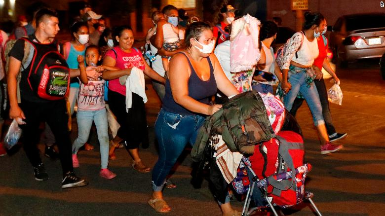 Hundreds of people walk along a highway in San Pedro Sula on Wednesday.