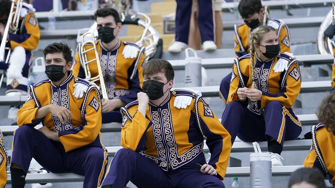 Members of the LSU marching band sit apart from one another before a college football game in Baton Rouge, Louisiana, on September 26.