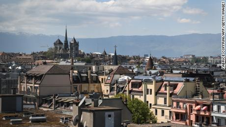 A 2019 file photo shows the St. Pierre Cathedral overlooking the roofs in the center of Geneva, Switzerland.