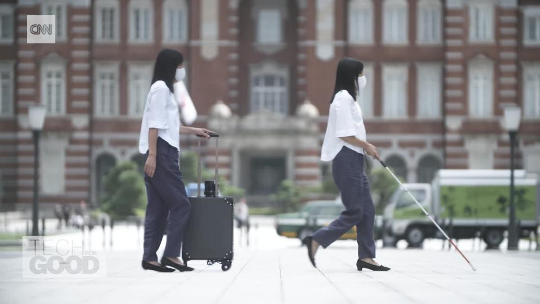 Robot suitcase designed as travel companion for blind people – CNN Video