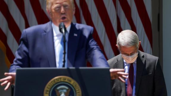 National Institute of Allergy and Infectious Diseases Director Dr. Anthony Fauci looks down as U.S. President Donald Trump speaks about administration efforts to develop a coronavirus disease (COVID-19) vaccine in the Rose Garden at the White House in Washington, U.S., May 15, 2020. REUTERS/Kevin Lamarque     TPX IMAGES OF THE DAY