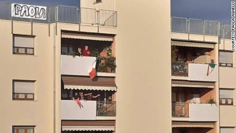 Michele D'Alpaos wrote Paola Agnelli's name on a bedsheet and hung it on top of his apartment building in a gesture to show his love.