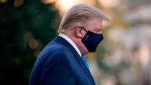 Trump's photo op raises new questions about how seriously he takes the virus