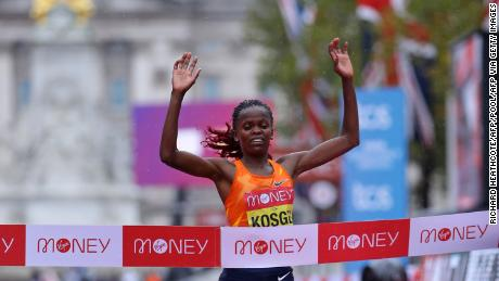 Kosgei crosses the finish line to defend her title in London.