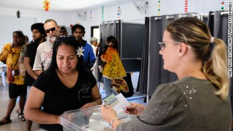 A woman casts her vote at a polling station in Nouméa, the capital of New Caledonia, on Sunday.