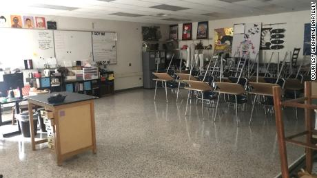 Gerianne Bartlett's classroom in Winston-Salem, NC, sits empty as she teaches students from home and works overtime to convert lessons to online formats.