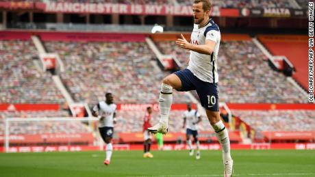 Harry Kane celebrates scoring Tottenham's third goal.