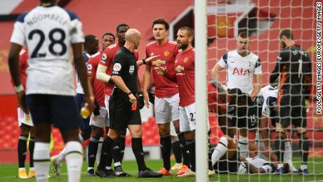 Anthony Taylor shows Manchester United's Anthony Martial a red card.