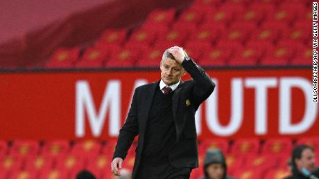 Solskjaer walks off the pitch following his side's defeat.