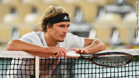 Zverev leans on the net during his match against Pierre-Hugues Herbert at the French Open.
