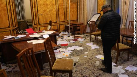 Documents are scattered across a room in the White House after it was ransacked by protesters.