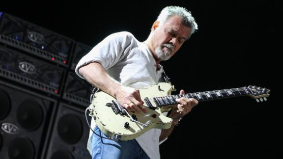 Eddie Van Halen of Van Halen performs at the Irvine Meadows Amphitheatre on Tuesday, July 14, 2015, in Irvine, Calif. (Photo by Rich Fury/Invision/AP)