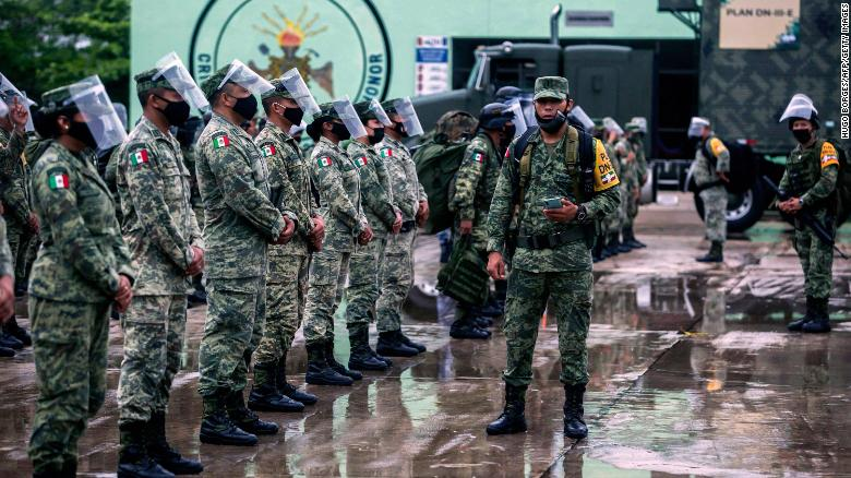 Members of the Mexican Army prepare to move toward Valladolid and Tizimin, in Yucatan state, before the arrival of Hurricane Delta.