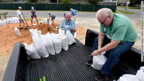 Sandbags were provided by Okaloosa County on Florida's Gulf Coast Tuesday in preparation for the potential arrival of Hurricane Delta.