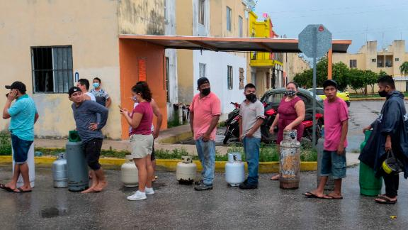 Residents in Cancun line up to buy gas prior to the arrival of Hurricane Delta.